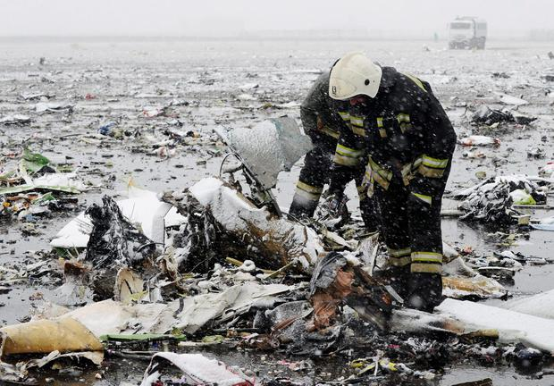 Emergencies Ministry members search the wreckage at the crash site of Flight number FZ981, a Boeing 737-800 operated by Dubai-based budget carrier Flydubai, at the airport of Rostov-On-Don, Russia, March 19, 2016