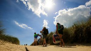 People enjoy the good weather and make their way to Curracloe beach, Co Wexford last week. Picture; Gerry Mooney.
