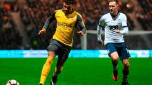 Alex Oxlade-Chamberlain of Arsenal is chased by Aidan McGeady of Preston North End