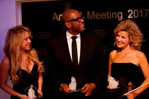 Colombian singer Shakira, U.S. actor Forest Whitaker and German violinist Anne Sophie Mutter pose for the media after receiving the Crystal Award at the annual meeting of the World Economic Forum (WEF) in Davos, Switzerland January 16, 2017.  REUTERS/Ruben Sprich