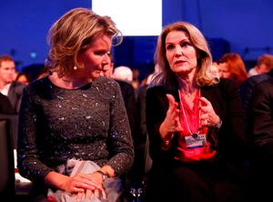 Belgium's Queen Mathilde (L) listens to Former Danish Prime Minister and CEO of Save the Children International Helle Thorning-Schmidt druing the Crystal Awards ceremony of the annual meeting of the World Economic Forum (WEF) in Davos, Switzerland January 16, 2017.  REUTERS/Ruben Sprich