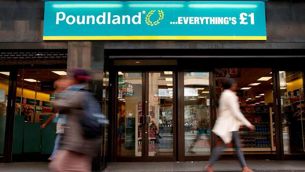 A Poundland shop in Glasgow, as the discount retailer, which faces a probe into its takeover of rival 99p Stores, said its annual sales topped £1 billion for the first time. Photo: PA