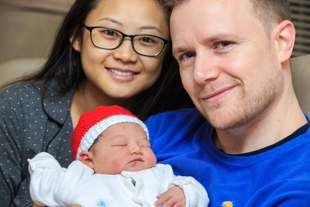 Mia Wang and David Hackett with their Christmas baby Kaia, who was born in the Coombe. Photo: Mark Condren
