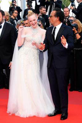 """Elle Fanning and President of the Main competition jury Alejandro Gonzalez Inarritu attends the closing ceremony screening of """"The Specials"""" during the 72nd annual Cannes Film Festival on May 25, 2019 in Cannes, France. (Photo by Pascal Le Segretain/Getty Images)"""