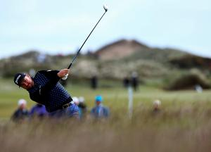 Graeme McDowell plays from the rough on the 18th during day one of the Dubai Duty Free Irish Open at Royal County Down Golf Club, Newcastle.  Brian Lawless/PA Wire.