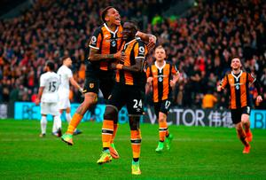 Oumar Niasse of Hull City (24) celebrates with Abel Hernandez as he scores their first goal. Photo: Getty
