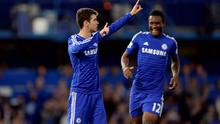 Chelsea's Oscar celebrates after scoring his team's winner with teammate John Obi Mikel