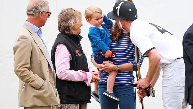 TETBURY, ENGLAND - JUNE 14:  Prince Charles, Prince of Wales, looks on as his son talks to Prince George of Cambridge and Catherine, Duchess of Cambridge as they attend the Gigaset Charity Polo Match at Beaufort Polo Club on June 14, 2015 in Tetbury, England.  (Photo by Chris Jackson/Getty Images)