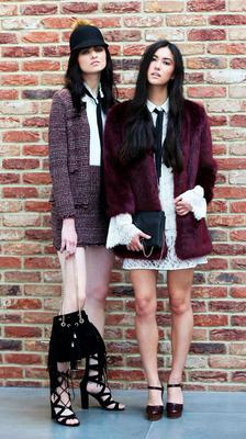 Pictured (l to r) Maria wears Knitted Jacket €18, Knitted Skirt €14, Cream Blouse €13, Suede Bag €16, Lace Up Sandal €26 and Li Ann wears Burgundy Faux Fur Coat €40, Cream Lace Bow Blouse €23, Cream Lace Dress €28, Burgundy Mock Croc Platforms €22, Black Chain Detail Bag €10. Photograph: Leon Farrell / Photocall Ireland