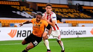 Wolves' Adama Traore and Konstantinos Tsimikas of Olympiacos in action. Photo: Getty Images