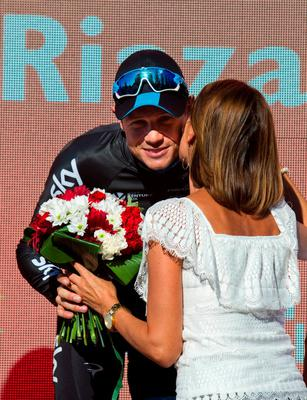 Sky's Irish cyclist Nicolas Roche is kissed as he celebrates on the podium after winning 18th stage of the 2015 Vuelta Espana cycling tour, a 204 km route between Roa and Riaza on September 10, 2015. AFP PHOTO / JAIME REINAJAIME REINA/AFP/Getty Images