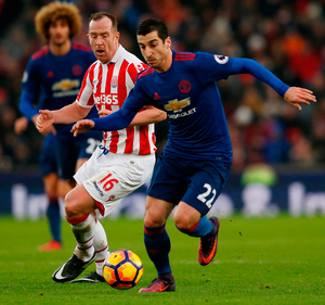 Manchester United's Henrikh Mkhitaryan in action with Stoke City's Charlie Adam. Photo: Andrew Boyers/Reuters