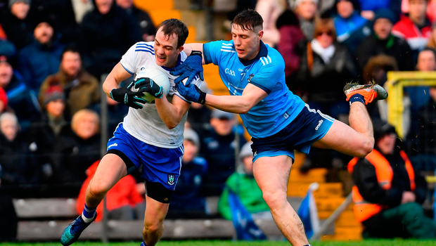 Jack McCarron of Monaghan is fouled by John Small of Dublin