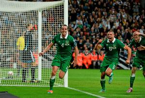 John O'Shea, Republic of Ireland, celebrates after scoring his side's equalising goal against Germany with team-mate Jonathan Walters