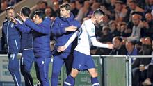Tottenham's Troy Parrott with manager Mauricio Pochettino after being substituted in the 65th minute of last night's League Cup clash against Colchester. Photo: PA