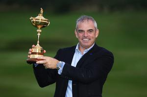 Europe team captain Paul McGinley poses with the Ryder Cup trophy after the Singles Matches of the 2014 Ryder Cup on the PGA Centenary course at the Gleneagles Hotel on September 28, 2014 in Auchterarder, Scotland.  (Photo by Ross Kinnaird/Getty Images)