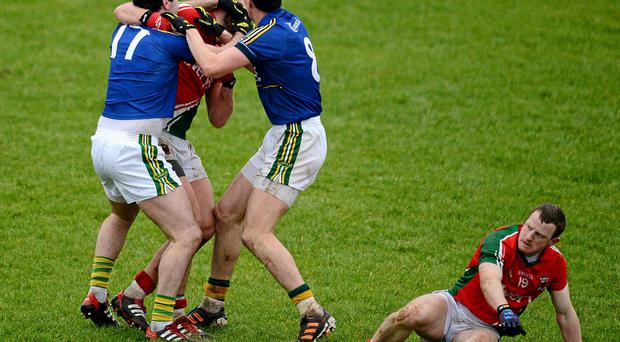 Brian Sheehan and Anthony Maher get to grips with Aidan O'Shea