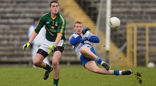 Monaghan's Kieran Hughes goes flying as he battles it out with Brian Menton
