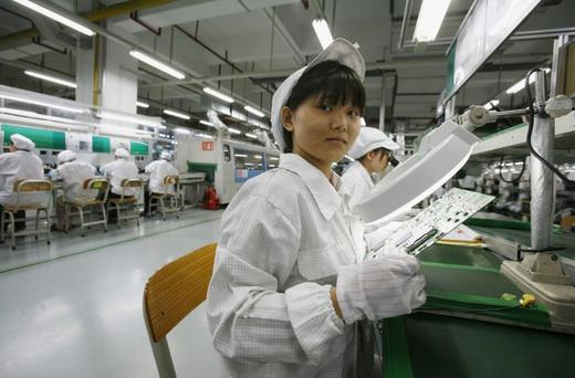 Workers in the Foxconn factory in the township of Longhua in the southern Guangdong province