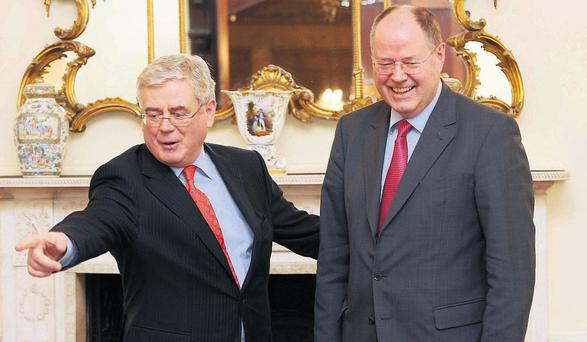 Tanaiste Eamon Gilmore welcomes German politician and Socialist Democratic Party (SDP) candidate for Chancellor, Peer Steinbrueck, at the Department of Foreign Affairs in Dublin