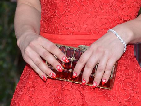 Kaley Cuoco wore her heart, not quite on her sleeve, but rather her fingernails