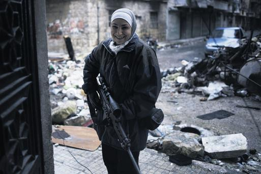 Female sniper Guevara, whose fame has spread throughout Aleppo, lost both her children in an air strike by Assad's forces
