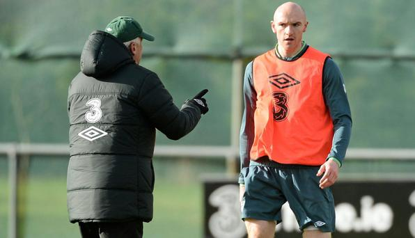Giovanni Trapattoni makes a point to Conor Sammon during the Irish training session in Malahide