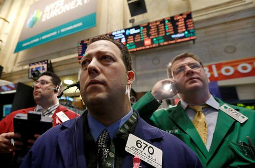 Traders await a price on the floor of the New York Stock Exchange