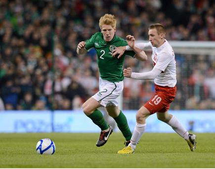 Paul McShane, Republic of Ireland, in action against Robert Lewandowski.