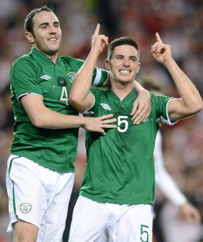 Ireland's Ciaran Clark, right, celebrates after scoring his side's first goal with team-mate John O'Shea.