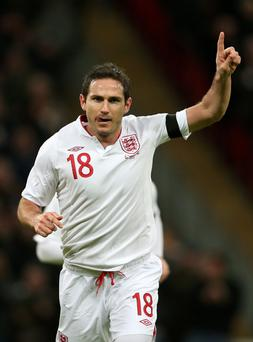 Frank Lampard of England celebrates after he scores his team's second goal.