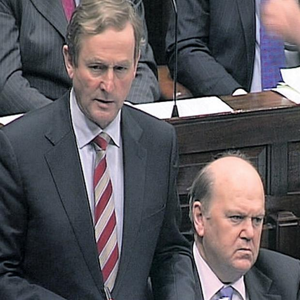 Taoiseach Enda Kenny with Finance Minister Michael Noonan as he addresses the Dail early today on legislation to facilitate liquidation of the IBRC, formerly Anglo Irish Bank