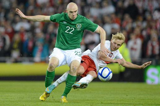 6 February 2013; Conor Sammon, Republic of Ireland, in action against Daniel Lukasik, Poland. International Friendly, Republic of Ireland v Poland, Aviva Stadium, Lansdowne Road, Dublin. Picture credit: Brian Lawless / SPORTSFILE