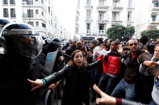 Tunisian protesters clash with riot police during a demonstration outside the Interior Ministry in Tunis after the death of liberal Tunisian opposition leader Chokri Belaid