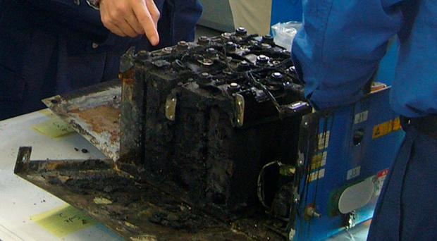 Investigators probe one of the batteries from a Dreamliner that was forced into an emergency landing in Japan