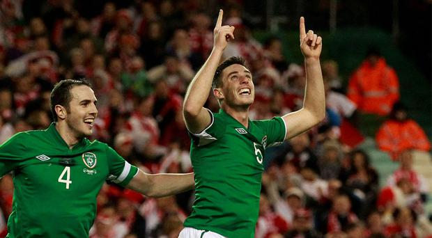06 February, 2013: Ciaran Clark is congratulated by team mate John O'Shea (L) after scoring against Poland during their friendly international soccer match at the Aviva Stadium