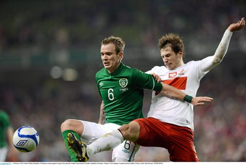 Glenn Whelan, Republic of Ireland, in action against Grzegorz Krychowiak, Poland.