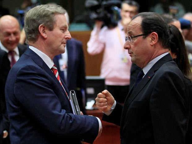 Taoiseach Enda Kenny with France' s President Hollande at a EU leaders budget summit meeting Brussels yesterday.