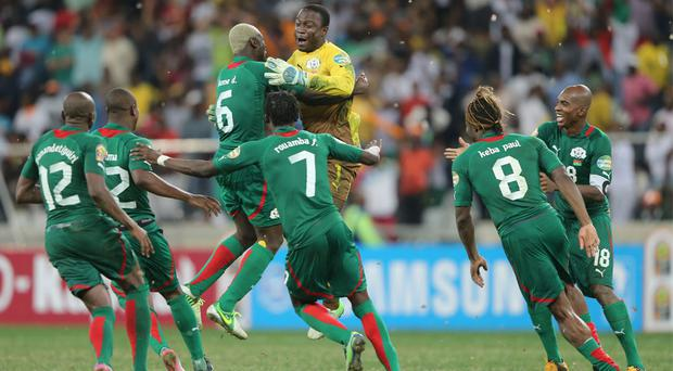 Goalkeeper Diakite Daouda (3rd R) of Burkina Faso celebrates victory with team-mates after saving a penalty in a shootout during the 2013 Africa Cup of Nations Semi-Final match between Burkina Faso and Ghana