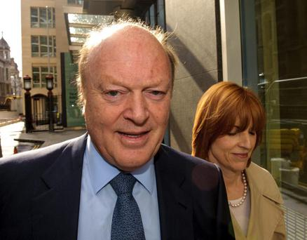 Derek Quinlan with his wife Siobhan leaving an earlier hearing of the case in the Rolls Building at the Royal Courts of Justice in Holborn, central London