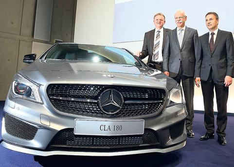 THE Daimler board of directors, Andreas Renschler (left), Bodo Uebber (right), and CEO of Daimler, Dieter Zetsche (centre), pictured during the company's annual press conference yesterday in Stuttgart, Germany, to highlight the firm's financial performance in 2012.
