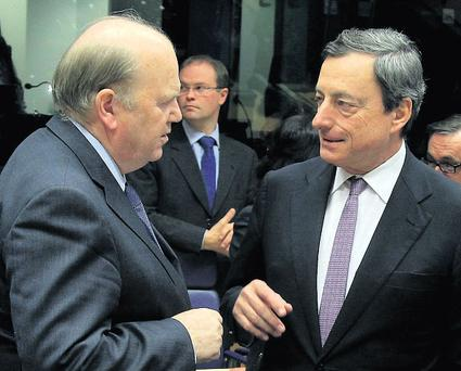 We're praying that Finance Minister Michael Noonan, pictured here with ECB chief Mario Draghi (right) has pulled a rabbit out of the hat with this deal – and that he doesn't let go of its ears