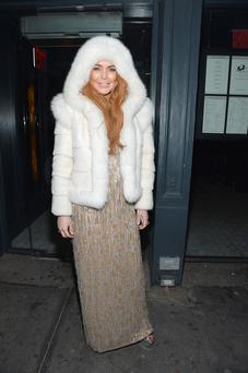 Lindsay Lohan wearing fur at New York fashion week opening night this week.