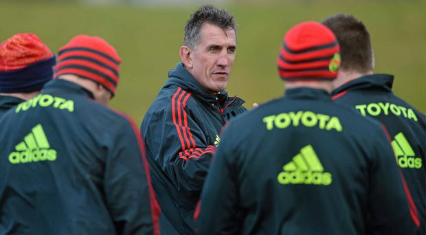Munster head coach Rob Penney speaks to his players during squad training