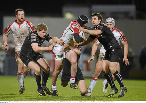 Ulster's Ricky Andrew is tackled by Jonathan Spratt, and Kahn Fotuali'i of Ospreys