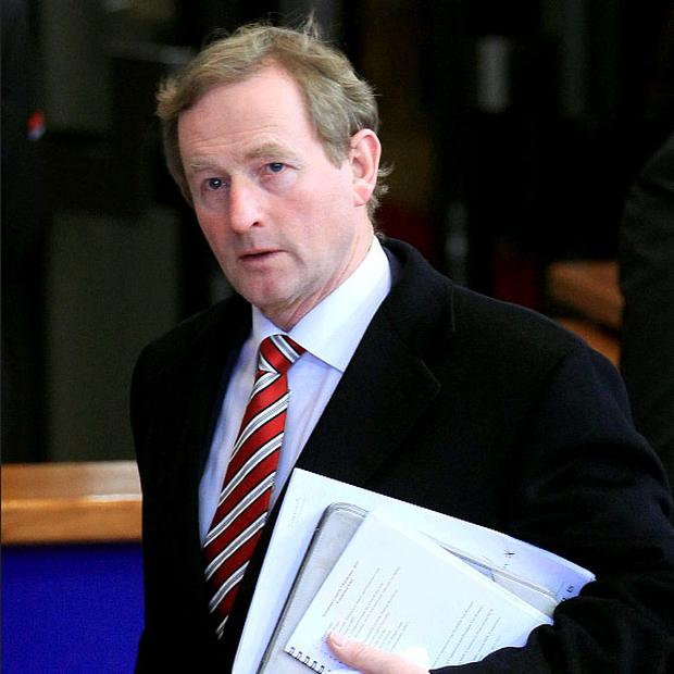 Taoiseach Enda Kenny leaves for a break during an European Union leaders summit meeting discussing the European Union's long-term budget in Brussels February 8, 2013.