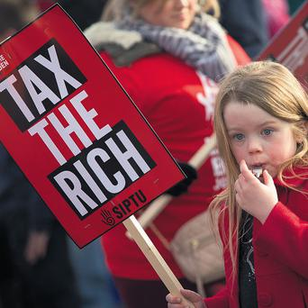 BLOWING THE WHISTLE: When this little girl is 45 the Anglo Irish Bank debt will be paid… so yesterday Sophie Hawkins, 5, from Kilmeaden, Co Waterford, joined the tens of thousands of people who took part in anti-austerity protests around the country.