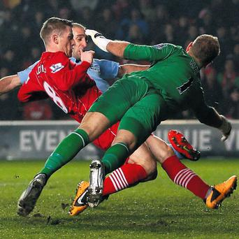Southampton's Steven Davis shoots the ball past Manchester City's Joe Hart to score his side's second goal yesterday at St Mary's Stadium