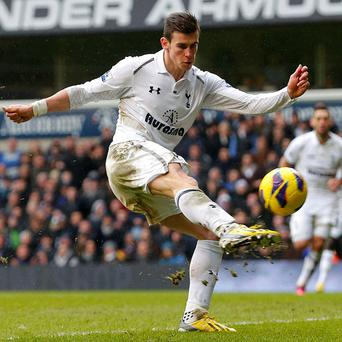 Gareth Bale takes a shot at goal against Newcastle United