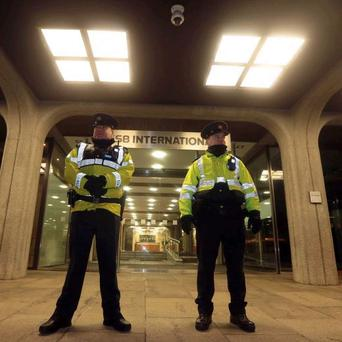 Two Gardai posted outside the former Anglo Irish Building as the board of the IBRC is stood down